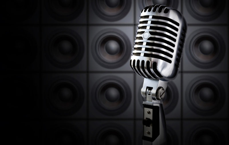 Tonight Show (Retro Microphone In Spotlight Against Wall Of Speakers)